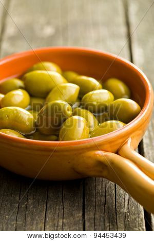 green olives in bowl on kitchen table