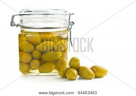 pickled green olives in jar on white background