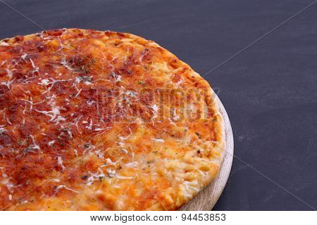 Cheese pizza on wooden table, closeup