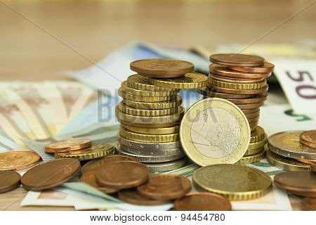 Euro coins and banknotes on the table.