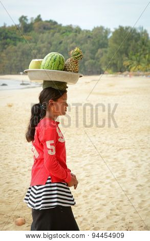 Burmese Woman Selling Fresh Fruits On Ngapali Beach