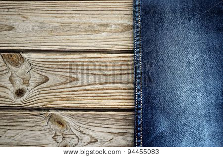 Jeans On A Wooden Background On The Right. Horizontal