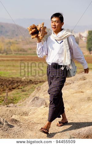 Burmese Man Carring Wood