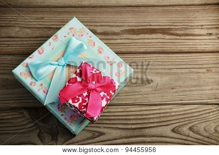 Two Gift Boxes On A Wooden Background. Horizontal