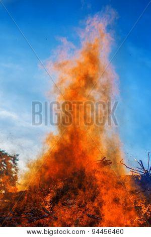 Big bonfire against blue sky