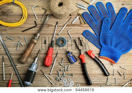 Gloves And Set Of Tools On A Wooden Table Horizontal