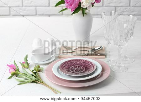 Beautiful table setting with flowers in vase close up
