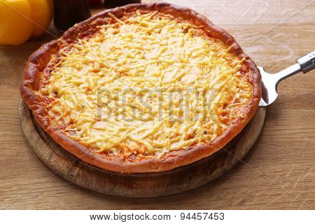Tasty cheese pizza on table close up