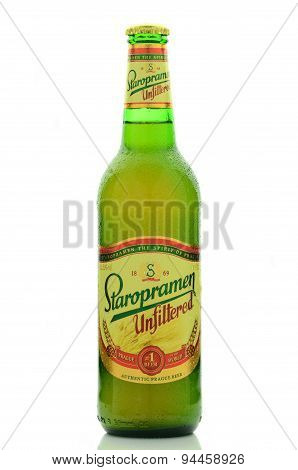 Staropramen unfiltered premium beer isolated on white background