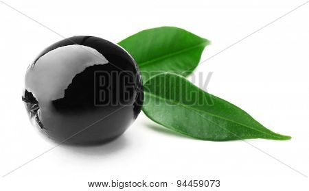 Black olive with green leaves isolated on white