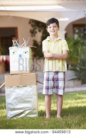 Boy Standing In Garden With Homemade Robot