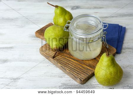 Pear juice with fresh fruits on wooden background