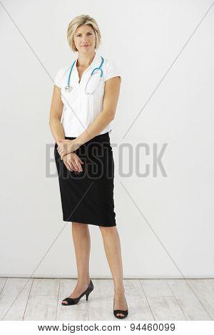 Studio Portrait Of Female Doctor Against White Background