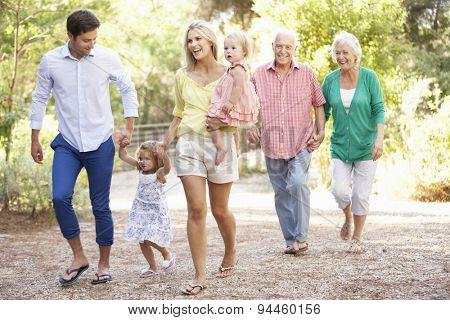 Three Generation Family On Country Walk Together