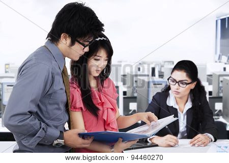 Busy Businesspeople Working At Workplace