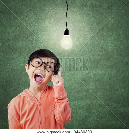 Cheerful Attractive Child Pointing At Lamp