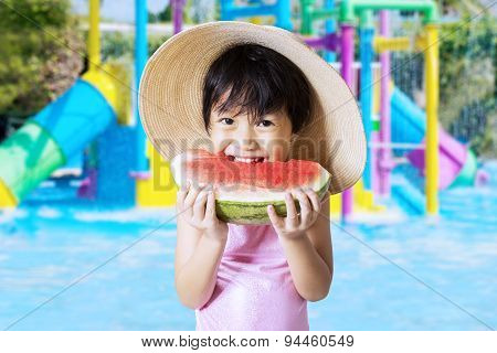 Child Eats Watermelon At Pool
