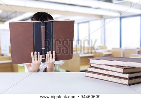 Child Reading Book Seriously At School