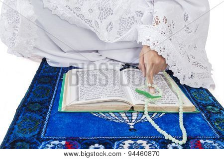 Closeup Of Muslim Woman Reading Koran