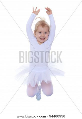 The little Girl is an acrobat jumps in a tracksuit
