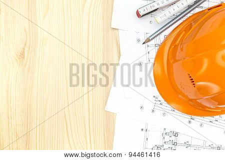 Safety Helmet With Architectural Plans And Wooden Ruler