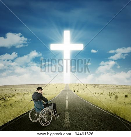 Disabled Businessman Praying On The Road