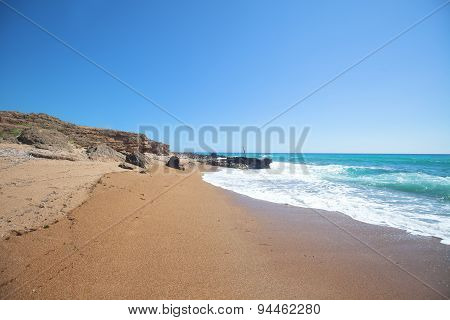 Sand Beach With Cliffs