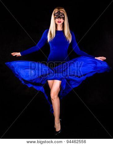 Beautiful Young Woman Dancing In A Long Blue Evening Dress