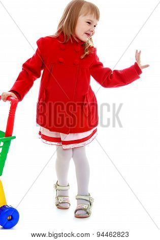 Fashion girl shopping and wheels the cart