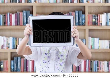 Girl Holds Tablet To Cover Her Face In Library