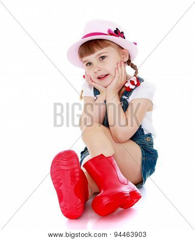 Sweet girl in red rubber boots