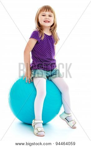 Big blue ball for fitness like the little girl who sat on him