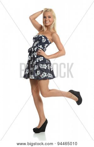 Portrait of beautiful teenage girl posing isolated over white background