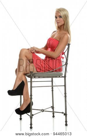 BEautiful teen girl sitting on chair isolated over white background