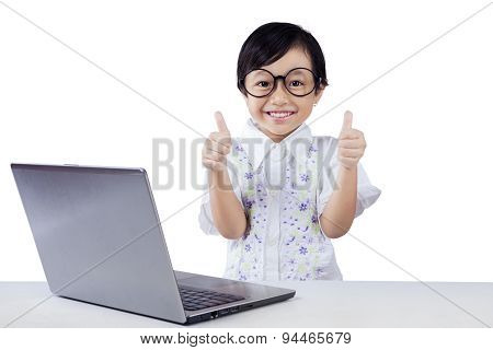 Modern Little Student With Laptop And Ok Sign