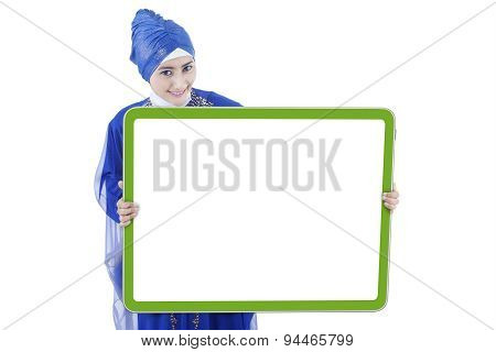 Muslim Woman Shows Empty Board