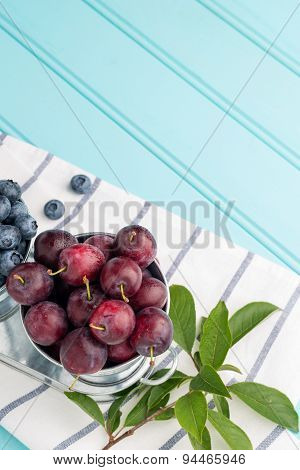 Plums In Small Metal Bucket