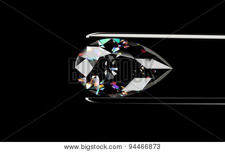 Pear shape Diamond in the tweezers on a black background