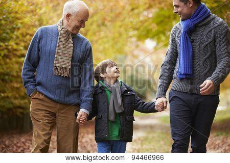 Male Multl Generation Family Walking Along Autumn Path
