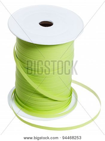 Plastic Bobbin With Green Packing Tape Isolated