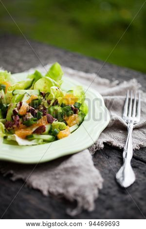 Summer salad with tangerine and nuts
