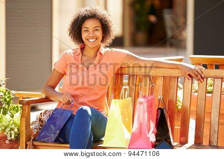 Woman Resting With Shopping Bags Sitting In Mall