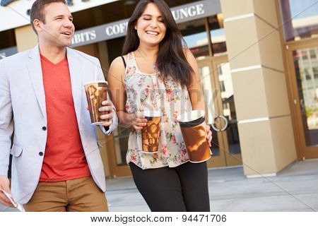 Couple Standing Outside Cinema Together