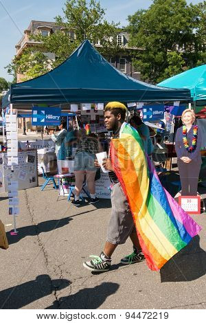 Man Wearing Lgbt Flag Before Hillary Stand During Rockland Pride