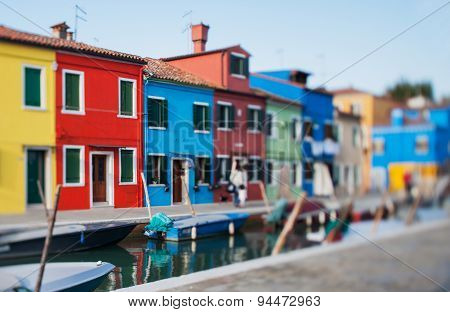 Tilt Shift Photo In Street Of Burano Island With Boat. Soft Focus