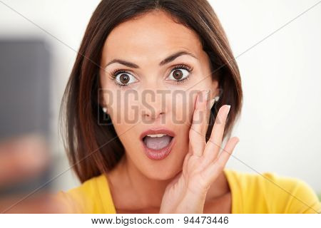 Young Woman Looking Surprised While Using A Mobile