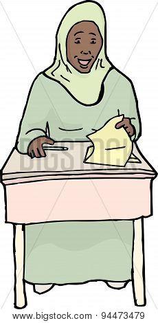 Happy Muslim Girl At Desk