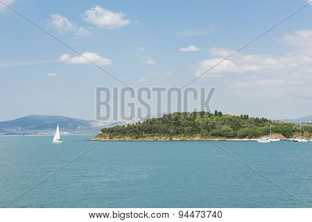 Small Island With Sailing Boats In Bosphorus