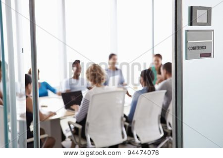 View Through Door Of Conference Room To Business Meeting