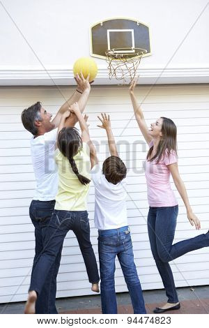 Family Playing Basketball Outside Garage
